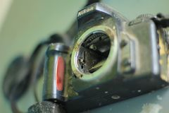 Broken and disassembled photo camera stock images