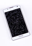Broken display on mobile phone. Broken mobile phone on background royalty free stock photo