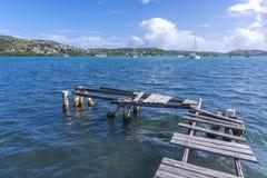 Broken dock in harbor Stock Photos