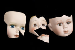 Broken Doll Face and Head on Black Background Royalty Free Stock Images