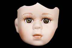 Broken Doll Face and Head on Black Background Royalty Free Stock Image