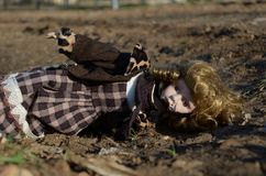 Broken doll on the ground. Broken porcelain doll lying on the ground Royalty Free Stock Photography