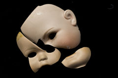 Broken Doll Parts on Black Background Royalty Free Stock Photo