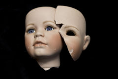 Broken Doll Parts on Black Background Royalty Free Stock Image