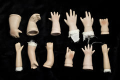 Broken Doll Parts on Black Background Royalty Free Stock Images