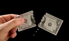 broken dollar Arkivfoto
