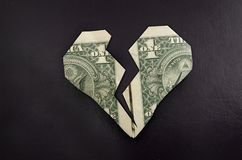 Broken dollar heart Royalty Free Stock Image