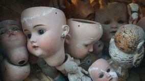 Broken dolls in a showcase stock images