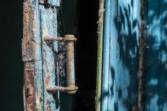 Broken door in blue and white colors Stock Photography