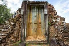 A broken door. Of a brick tower surrounding the central pyramid of Bakong temple mountain, Cambodia Royalty Free Stock Photos