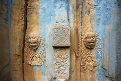 A broken door. Detail of a broken door of a brick tower surrounding the central pyramid of Bakong temple mountain, Cambodia Royalty Free Stock Photography