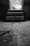 Broken door dirty floor Stock Images