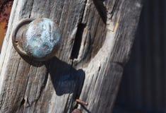 Broken door knob on broken timber door. On shed Royalty Free Stock Photography