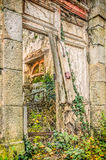 Broken door and medieval abandoned house in village Stock Images