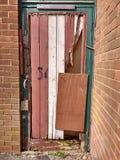 Broken Door. Old door broken and patched up Royalty Free Stock Photography