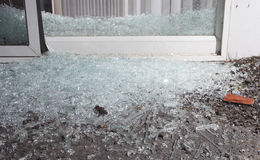 Broken Door. Sliding Glass Door That Has Been Shattered By A Home Invader  Stock Photos