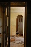 Broken doors in abandoned interior Stock Images