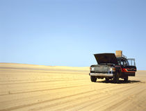 Broken down 4WD in the desert Stock Photo