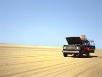 Broken down 4WD in the desert. Broken down 4WD in the Arab desert with the hood raised Stock Photo