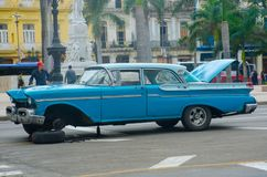 Broken down blue classic american car in streets of Havana. Havana Cuba - 26 January 2018: Broken down blue classic american car in streets of Havana Stock Images