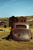 Broken down car in ghost town Royalty Free Stock Image
