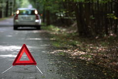 Broken down car with warning triangle Royalty Free Stock Photography