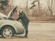 Broken down car, woman calling to somebody Stock Photo