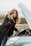 Broken down car, woman calling to somebody Stock Photography