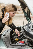 Broken down car, woman calling to somebody Stock Images