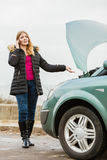 Broken down car, woman calling to somebody Stock Image