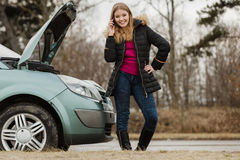 Broken down car, woman calling to somebody Royalty Free Stock Images