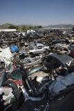 Broken Down Cars At Junkyard. Wrecked and broken down cars at an automotive junkyard Stock Photos