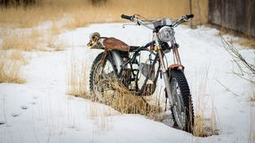 Broken down motorcycle in the show with no engine and rusted Royalty Free Stock Image