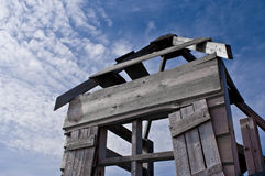 Broken down shed under a cloudy sky. Old shed brought to live by a cloudy blue sky Stock Photo