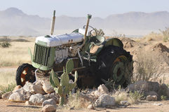 Broken-down tractor. In the desert Royalty Free Stock Images