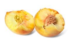 Broken down into two parts ripe peach Stock Photos