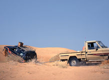 Broken down vehicle in the sand of the desert Royalty Free Stock Photography