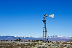 Broken-Down Windmill On Desert Farm Stock Photos