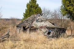Broken-down wooden house stock image