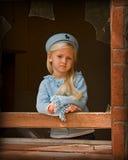 Broken dreams. Little girl looking out broken window Stock Photography