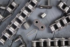 Broken driving roller chain. Parts of destroyed industrial chain. Broken driving roller chain. Parts of destroyed industrial driving roller chain stock image