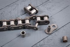 Broken driving roller chain. Parts of destroyed industrial chain. Broken driving roller chain. Parts of destroyed industrial driving roller chain royalty free stock image