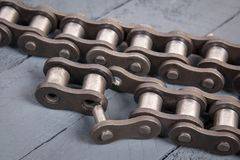 Broken driving roller chain. Parts of destroyed industrial chain. Broken driving roller chain. Parts of destroyed industrial driving roller chain Royalty Free Stock Photos