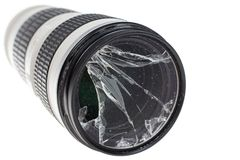 Broken DSLR camera lens filter glass, isolated on white. Background Royalty Free Stock Photos