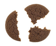 Broken Dutch cocoa cookie on a white background Stock Photos