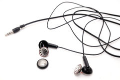 Broken earphones isolated on white background. Stock Photos