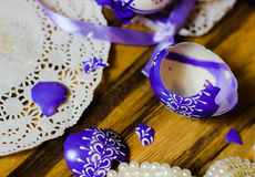Broken Easteregg lilac ribbon lace Royalty Free Stock Photography
