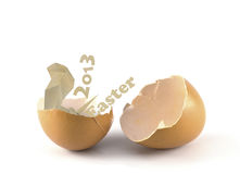 Broken egg and 2013 easter with paper snake. On white background Royalty Free Stock Image