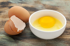 Broken egg in a bowl stock image