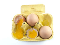 Broken egg in a carton box isolated Royalty Free Stock Image
